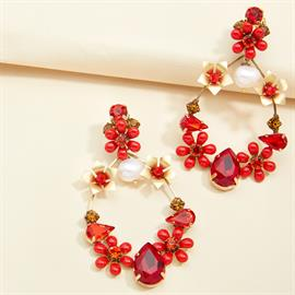 Teardrop-shaped earring elegantly hand-embellished with red crystals and enamel flowers. Accented with 18k matte gold-plating and pearl beads. SKU #E2344