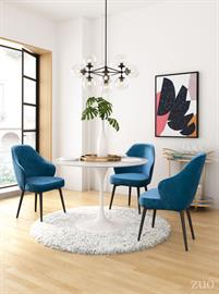 This lux velvet dining chair wraps you in comfort and invites guests to linger a while. Its modified wingback will update your dining room with its shapely silhouette. Beautiful tapered pencil legs make it sturdy.