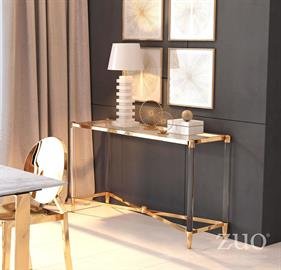 Undeniable chic the Existential Console table features a rectangular shape with tempered glass top, slim stainless steel frame with brilliant Gold finish; accented by lucite for a posh sophisticated elegance. Collection includes coffee, side, console tables and bar cart.