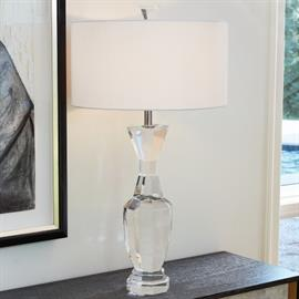 Talk about drama! Our Crystal Urn Lamp is a spectacular piece that will be sure to catch everyone's eye. The solid translucent crystal body with its octagonal shape and white silk shade make a luxurious statement. The striking French wired lamp is topped with a faceted jewel-like nugget.