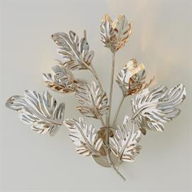 Abstract and organic, our Dancing Leaves Sconce is a whimsical way to light your space. The brilliant polished nickel finished leaves seem to dance and move with the light. The flexible leaves can be moved to control the lighting and how much of the bulb you actually see.