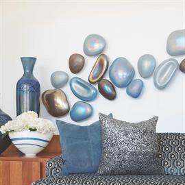 Iridescent finished glass forms uniquely shaped glass river rocks.  In three color tones – light blue, dark blue and bronze.   Mounts individually with cast iron off-white power painted holders.   Easy to install.