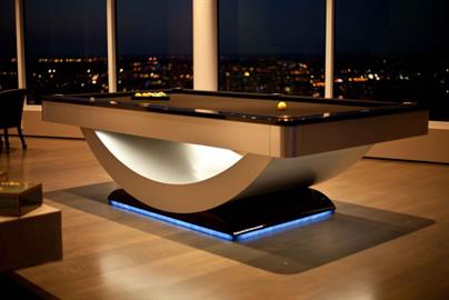 The Reverse Rainbow Billiard Table features an ever changing glow and professional billiard surface.  Call for details.