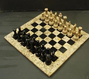 Chess set carved out of Fossil Stone and Black Onyx