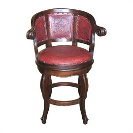 hand tooled leather barstool. red leather. and hand carved wood.