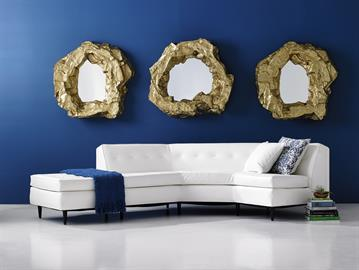 A mirror that deserves a second look. Organic, glamorous, unexpected, its scale and style allows it to be the focal point of any room. Created out of artisan-grade resin and finished in hand applied gold leaf, this piece demands attention… literally.