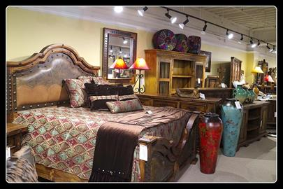 Elegant hand-tooled leather headboard and footboard are the center of attention in this grouping.