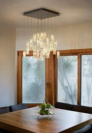 Galilee Lighting | Rain drops pendants chandelier, contemporary beautiful dining chandelier.  The art glass pendant lighting, are made with beautiful fused glass pendants. The modern chandelier can be designed with any number of pendants, any length and different colors. As part of our service, we advise our customers about the right size of chandelier for the space. the graceful contemporary chandelier for the foyer makes a statement right at the entrance to the house and brings the beauty of art to the
