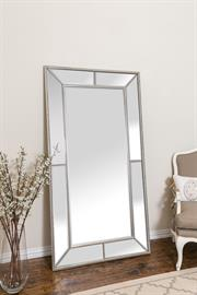 "Roxeburghe Leaner is transitional in style, feaaturing a brushed silver beaded trim finish on a wood frame, with inset beveled mirror glass panels.  Overall Dimension: 35.5"" x 67"" x 1.5"""