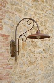 "Otello is a large sconce for indoor or outdoor use. The canopy and arm are aged brass; the shade is aged copper with a refl ector in white enameled aluminum, and a clear tempered glass globe. Otello is also available as a pole mounted street lamp with four pole size options (Item: LAR.161.1 and Item: PAL/..).  Width: 12.99"" Depth: 23.03"" Height: 26.38"" Canopy: 4.53"" W x 10.43"" H Lamping: 1 x 100W (E26). Use medium base incandescent, CFL, or LED bulb. Weight: 15 lbs  UL Listed for Wet Locations"