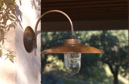 "La Traviata is an aged brass sconce, suitable for outdoor or indoor use, with a large aged copper shade and clear tempered glass globe.   Width: 13.78"" Depth: 16.93"" Height: 14.17"" Canopy: 5.91"" Dia Lamping: 1 x 100W (E26). Use medium base incandescent, CFL, or LED bulb. Weight: 9 lbs +/-  UL Listed for Wet Locations"