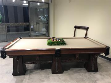 "This table is a one of a kind piece.  It is made by Brunswick and it is called the ""Kling"".  It was manufactured in 1916 and named after Johnny Kling who played for the Chicago Cubs in the early 1900's. Kling was the only person to have won a World Pocket Pool Championship and a World Series Title."