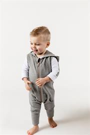 The jersey hooded romper is a must have this season. Cozy and stylish, with low pockets and a jogger leg fit. The copper zipper is the perfect accent, made to last.