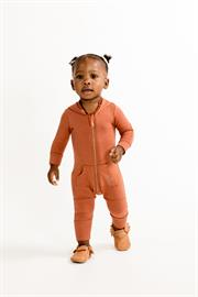 The jersey playsuit is an essential for fall and winter. The contrasting elbow patches and double layered knees are a durable finish for active toddlers. A full zipper extends from the neck to the left leg, making it easy to get on and off.