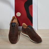 "The JOAN. Inspired by 1970s ""wedge"" running shoes.  The sportiest shoe in the collection retains the classic details typical to RUBIROSA. JOAN uses a bi-material and two tone sole, with an added spoiler for stability."