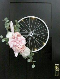 Put a stylish spin on this bicycle rim to turn any blank space into an eye-catching display.