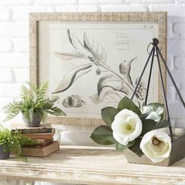 Warm, bright and airy with natural greenery and white floral elements.