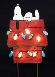 "Roman expands their popular line of metal marquee signs into licensed products. Roman's new Peanuts™ Marquee Yard Art features the iconic Snoopy character resting upon his doghouse. 5 C7 bulbs illuminate figure. Item comes attached to stake for easy outdoor displaying. Measures: 30"" H."
