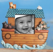 "This new Noah's Ark baby line includes this 4x4 frame standing at 9.5""H and is accompanies by a wall cross, keepsake boxes, and a bank."