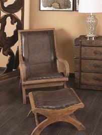 "Just the thing for resting in after a hard day riding the range or hunting wild game. Our solid wood frame chair and matching ottoman are upholstered in genuine saddle stitched leather trimmed with brass tone studs. 36"" high"