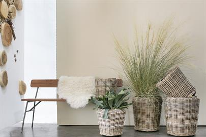 Beautiful rattan planters with plastic dry-pots make attractive indoor containers or planters for covered outdoor living spaces. Available in 5 sizes.