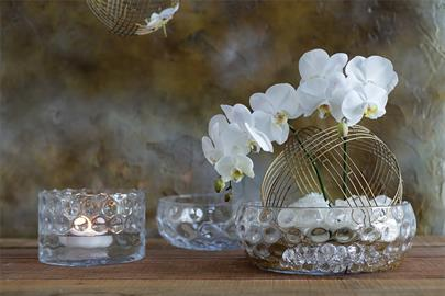 Stunning hand-blown glass bowls with  subtle, rippled dot design look stunning with floating flowers or candles.