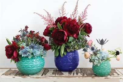 This collection of vibrant colored ceramic vases looks rich and bold in a high gloss finish. Available in Seafoam or Colbot, in 3 sizes.