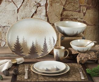 Shadowy pine tree silhouettes on cream speckled stoneware evokes a winter forest feeling for your table. This 16 piece dinner set includes dinner plates, 4 salad plates, 4 bowls and 4 cups. Dishwasher safe. Coordinating pieces available separately.