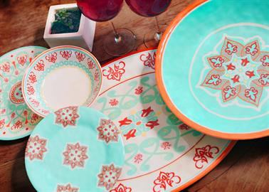 This Western Motif Melamine Dinnerware will add a pop of color to your table top. Vibrant shades of turquoise, red and oranges will brighten any table setting. Colorful medallian designs adron each piece. Built to last melamine is perfect for outdoor barbecues, family gatherings and durable enough for daily use. Made of melamine.