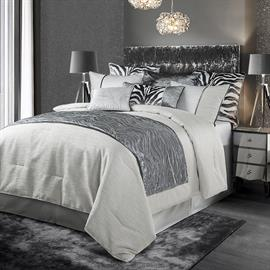4 PC Celeste Comforter Set includes comforter, bedskirt and two shams.  Beautiful zebra and gray velvet decorative pillows and bed scarf add elegance to this ensemble.