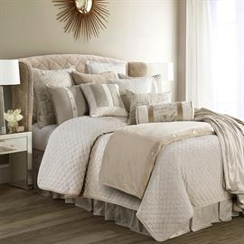 Natural quilted linen and luxe velvet combine with stylish French script to bring tasteful and understated luxury into any room. A neutral color palette and classic textures provide a canvas for versatile styling.