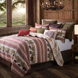 Show your love of nature with this gorgeous quilt set. Reversible quilt set features a forest scene complete with bears, trees and mountains. Complemented with hues of brown, tans, green and deep red. Reverses to a beautiful tan plaid.
