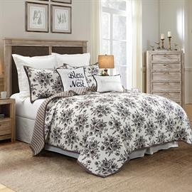 Lyla Reversible Floral 3 piece Quilt Set in ivory, black and tan will be perfect for your modern farmhouse look.