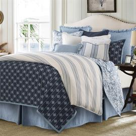 Add peaceful tranquility to your bedroom with the reversible Skylar Quilt set. Fabric beautifully emulates detailed shibori dying techniques. Quilt and shams reverse to a deep blue stripe with medallion print.