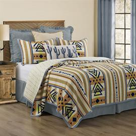 Give your bedroom a Southwest feel with the Pontiac Quilt Set. In vibrant hues of blue, ivory, tan and yellow, this reversible quilt set features a bold Aztec inspired geometric pattern.
