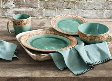 This beautiful turquoise dinnerware set contains delicate cream scroll edge accents. Scroll edge accents pays homage to hand-tooled leather. Sixteen piece dinner set includes 4 dinner plates, 4 salad plates, 4 bowls and 4 cups.