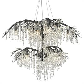 Like dewdrops under a forest canopy, the Autumn Twilight collection displays glistening glass beads that cascade from organic leaves and branches. This nod to nature gets a modern twist with a Black Iron finish making it natural in contemporary settings. Candelabra bulbs provide an inner source of illumination that causes the light to sparkle and reflect playfully off the countless gleaming surfaces sparking both curiosity and conversation.  Cascading glass beads Organic sculpted branches