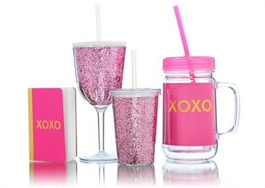 Traditional elegance and contemporary flair create a line of acrylic tumblers, cocktail napkins, and printed invitations.