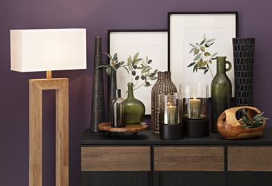 Earthy, organic and transitional, this trend features clean lines and neutral hues accented with green. Wovens and artisan glass complete the look.