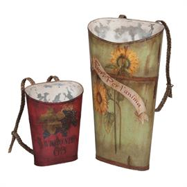 203524s Set of two reclaimed tin wine baskets with hand painted graphics and art. Hand woven natural basket straps with buckles. Lg 36x20x10 Sm 20x15x8