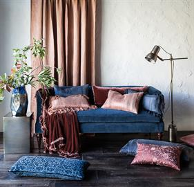 Our Cotton Velvet Settee, surrounded by a rich assortment of items in our two new Accent Colors: Midnight and Rosegold
