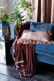 Our Loulah Throw Blanket glows in Rosegold atop our Midnight Velvet settee