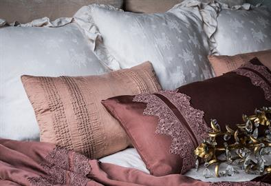 Our new Satin with Venice Lace Lumbar Pillow in Rosegold, flanked by Rosegold Arielle Accent Pillows, makes quite the statement