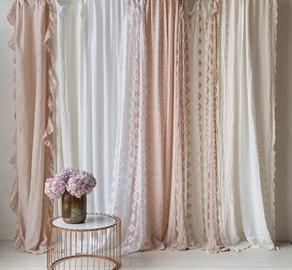 An assortment of delicate curtains in White, Winter White and Pearl.