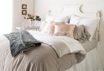 Our Helane Duvet Cover is oh-so inviting in Fog, with accents of White and a pop of Rosalina Warm.