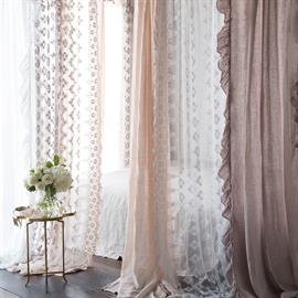 An oasis of Olivia and Linen Whisper Curtains in Powder, Pearl and White.