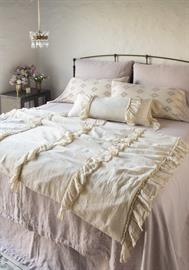 Our new Linen Whisper wedding blanket, featured in Parchment, adds whimsy to any room.