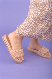 Sporty and chic, puffy woven uppers lend an unexpected feminine touch to these easy monochromatic slide sandals.