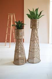 Set of two seagrass and iron planter towers