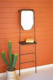 Leaning metal mirror with shelf